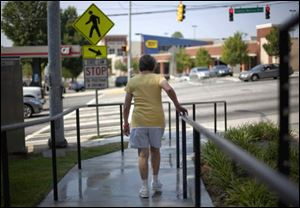 An elderly Atlanta resident uses a newly constructed ramp.