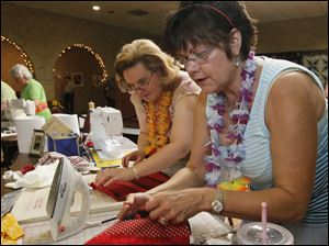 Amy Reitzel, of Ottawa Lake, left, and Debbie Linenkugel , of Toledo, compete in the Iron Quilter competition. They are members of