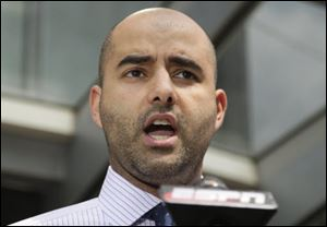 NFL Players Association spokesman George Atallah speaks to media in Washington.