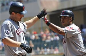 Cleveland Indians' Austin Kearns, left, is congratulated by Luis Valbuena after his solo home run off Minnesota Twins' Matt Capps in the ninth inning of the first baseball game of a doubleheader Monday.