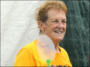 Mary Brigman, from Toledo, fans herself during a break from the UFCW Local 75 tent during the Ottawa County Fair in Oak Harbor.
