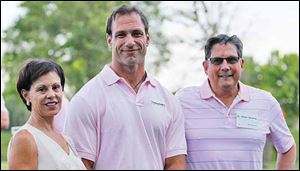 Debbie Knight, Chris Spielman, center, and Dr. Robin Shermis at the putting tournament at Belmont Country Club.