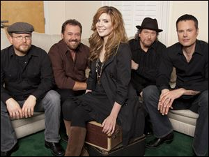 Alison Krauss, center, poses with Union Station, from left, Ron Block, Dan Tyminski, Krauss, Jerry Douglas, and Barry Bales.