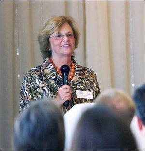Mary Ellen Mazey, who took over the presidency of Bowling Green State University July 1, addresses businessmen at the Bowling Green Chamber of Commerce at Stone Ridge Golf Club. She's already met with local economic development officials and Toledo Mayor Mike Bell, sampled the parks and golf courses, and has gotten to know the police pretty well, Ms. Mazey joked.