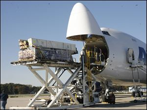 Cargo to be sent to Sydney, Australia, is loaded onto a plane at the BAX global cargo sorting hub at Toledo Express Airport in this file photo.