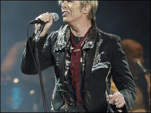 Singer/songwriter David Bowie performs at Madison Square Garden in this 2003 file photo.