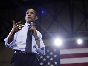 President Barack Obama answers questions Friday during his Town Hall at the Ritchie Coliseum on the campus of University of Maryland.