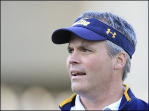 In 2 years Tim Beckman, shown at spring game, helped UT improve on field and classroom.