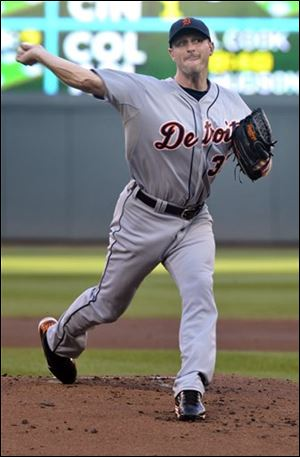 The Tigers' Max Scherzer pitches against the Twins during the first inning.