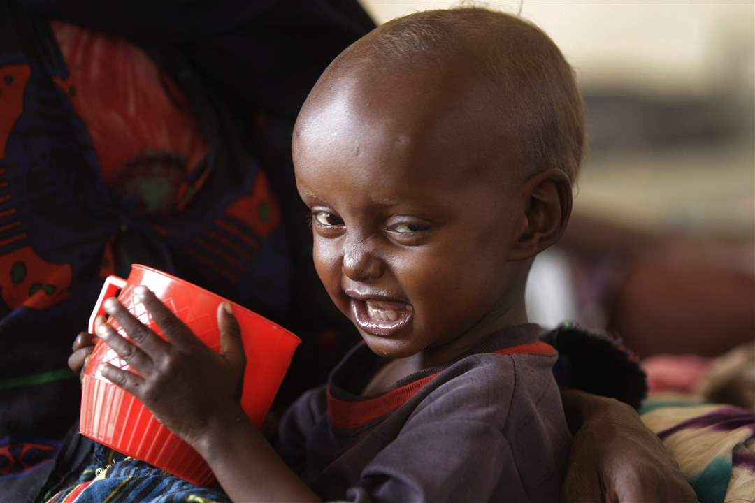 Kenya-child-red-cup-grin