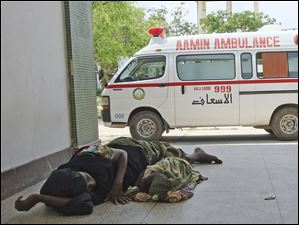 A malnourished woman and her child from southern Somalia lie outside the Banadir hospital in Mogadishu, Somalia.