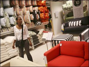 A customer looks at sofas at an IKEA store in New York.