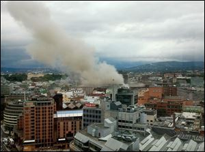 Smoke rises from the central area of Oslo on Friday after an explosion.