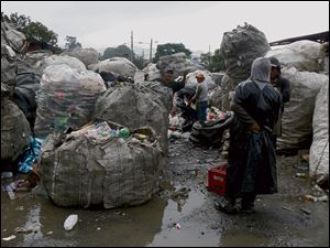 Dump workers sort through materials in Guatemala City's Zone 3.