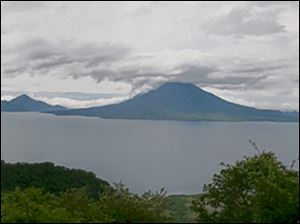Lake Atitlán, a crater lake, is guarded by three volcanoes. Guatemala, slightly smaller than Tennessee, has 33 active volcanoes.