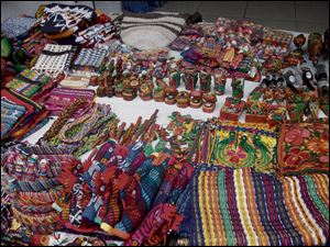 Colorful handmade crafts for sale in Santiago, Atitlan.