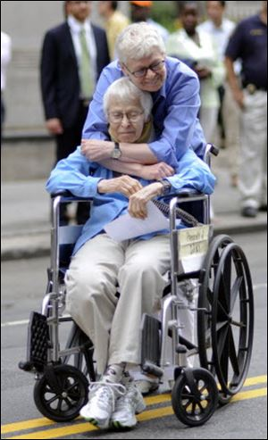 Phyllis Siegel, 77, hugs Connie Kopelov, 85, after becoming the first same-sex couple to get married at the Manhattan City Clerk's office on Sunday.
