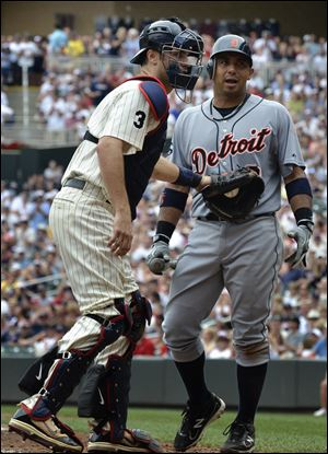Twins catcher Joe Mauer tags out the Tigers' Carlos Guillen after he struck out in the ninth inning Saturday in Minneapolis.
