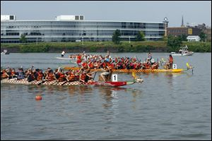 Dragon boat racing teams of 25 people -- 20 paddlers, a steersman, a drummer, and three alternates -- raised a minimum of $2,000 to participate in three races during the day, with the first-round times determining their placement in the next two rounds.