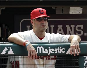 Indians manager Manny Acta watches the team play the Chicago White Sox during the ninth inning Sunday. The Tribe lost 4-2.