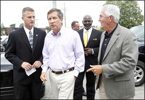 ODOT District Two Deputy Director, Todd Audet, Gov. John Kasich, Toledo Mayor Michael Bell, and Transportation Director Jerry Wray,  arrive for a news conference at ODOT on Douglas Avenue.