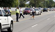 Police-officer-stops-traffic-at-U-S-Senior-Open