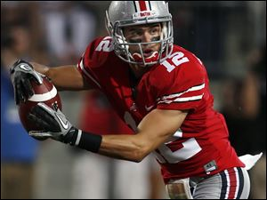 Central Catholic and Ohio State grad Dane Sanzenbacher signs with the Chicago Bears.