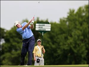 Dick Anderson throws up dirt on the first fairway Wednesday during practice rounds for the U.S. Senior Open at the Inverness Club in Toledo.