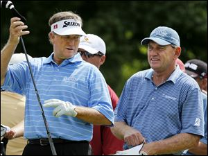 Golfers Peter Jacobsen, left, and Nick Price prepare for their tee shots on the 18th hole.