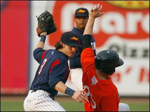 Toledo Mud Hens player Will Rhymes (3) tags out Norfolk Tide player Brandon Snyder (29) as he tries to steal second base in the second inning.
