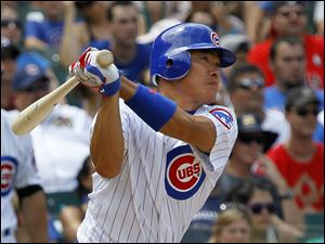 Chicago Cubs' Kosuke Fukudome hits a triple off Houston Astros relief pitcher Sergio Escalona on Saturday in Chicago.