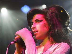 British singer Amy Winehouse performs at the Volkshaus in Zurich, Switzerland, in this Oct. 25, 2007 file photo. Winehouse was found dead July 23, 2011, by ambulance crews who were called to her home in north London's Camden area. She was 27.