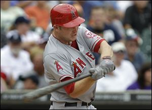 Los Angeles Angels' Mark Trumbo hits a two-run home run during the second inning of a baseball game against Detroit.