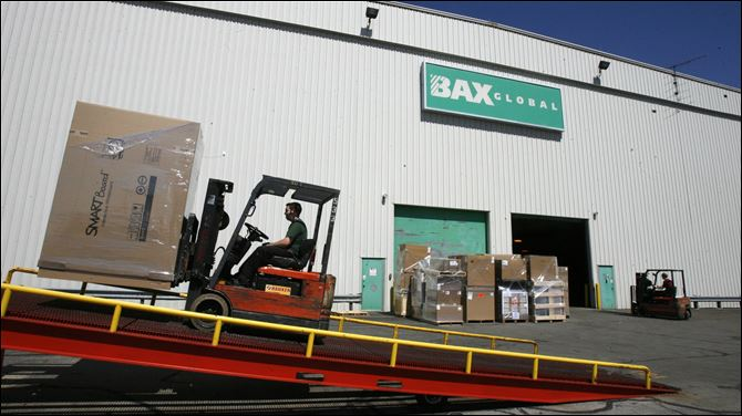 BAX Global forklift boxes A forklift driver loads boxes onto a truck at the BAX Global hub at Toledo Express Airport in this May 16, 2008, file photo.