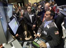 Traders-gather-on-New-York-Stock-Exchange-floor
