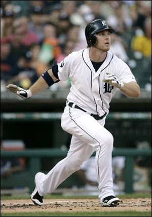 The Tigers' Brennan Boesch watches his solo home run in the first inning of a baseball game against the Los Angeles Angels.