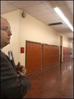 Dan Burns, then acting business manager for Toledo Public Schools, is seen at the former DeVilbiss High School in this Jan. 14, 2002, file photo.