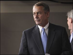 House Speaker John Boehner of Ohio prepares to speak during a news conference on Capitol Hill.
