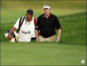 Michael Allen, right, with his caddie, Mike Kerr, approach the 18th green at Inverness Club. Allen is tied with Marl Calcavecchia and Joey Sindelar for third place in the U.S. Senior Open.