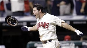 Cleveland Indians' Matt LaPorta celebrates as he comes home to get mobbed by teammates after hitting a three run home run off Kansas City Royals relief pitcher Joakim Soria in the ninth inning Saturday.