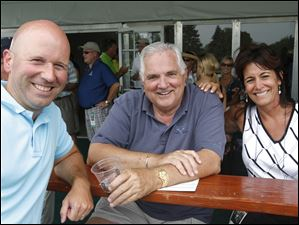 From left, Aaron Bieszczad, Tom Schlachter, and Tracy Sallah in the Jack Nicklaus village.