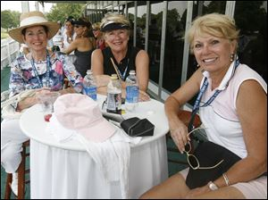 From left, Mary Ann Kline, Sue Nassar, and Linda Dunbar in the members tent at the U.S. Senior Open.