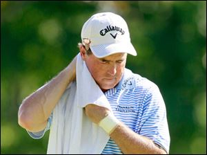 It was another hot day at Inverness Club. Leader Olin Browne wipes the sweat off his neck before continuing play.