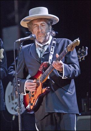 Legendary musician Bob Dylan, shown here at London concert in June, performed Wednesday night at the Toledo Zoo.