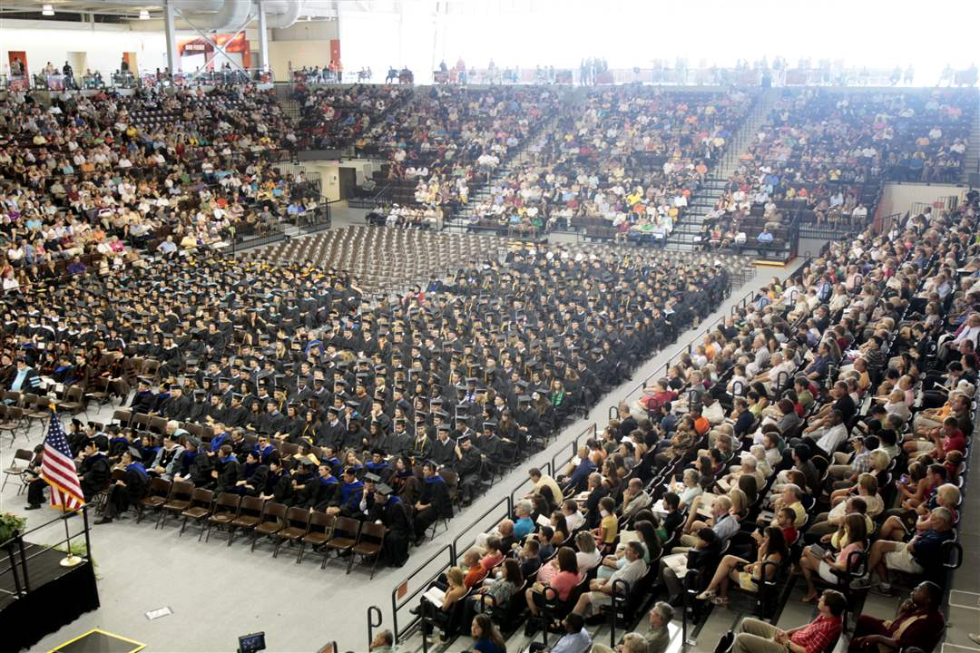 Crowd-sits-in-Stroh-Center-for-commencement