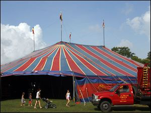 People leave after the Kelly Miller Circus sets up its tent Monday in Kelleys Island, Ohio.