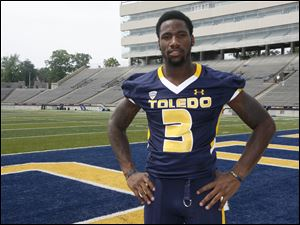 The Rockets' Cordale Scott will get to see his 2-year-old son more playing at Toledo instead of Illinois.