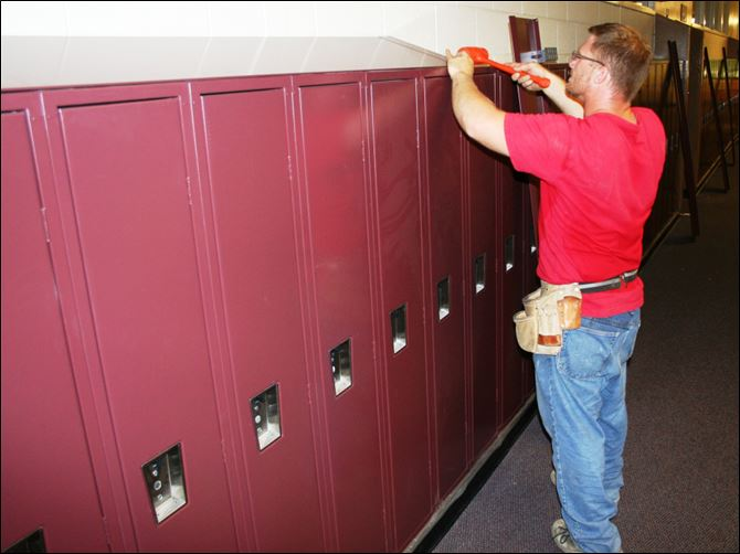 Brandon Bartson Brandon Bartson installs new lockers at Custer II Elementary School in Monroe.