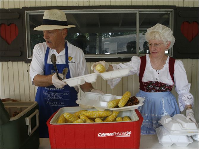 Ron and Judy Diener Ron and Judy Diener of Temperance, Mich., serve chicken and corn during the Teutonia Mannerchor's Kornfest.