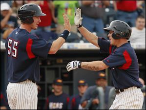 Toledo's Brandon Inge, right, high-fives Ryan Strieby (55) after hitting a home run.